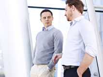 Corporate executives discussing business in office Stock Image
