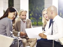 Corporate executives meeting discussing business in modern build Stock Photo
