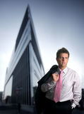 Corporate Feeling. Businessman stands in front of a modern office building Stock Photography