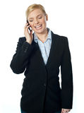 Corporate female communicating on phone. Against white background Royalty Free Stock Photos