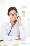 Corporate female employee talking on the phone Stock Photo