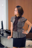 Corporate girl. An asian girl in a corporate environment with the background of the work area Royalty Free Stock Images