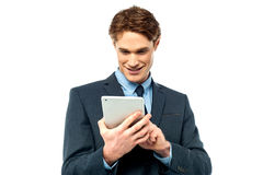 Corporate guy browsing on his tablet pc Stock Images