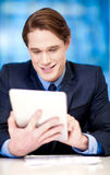 Corporate guy browsing on tablet pc Stock Photos
