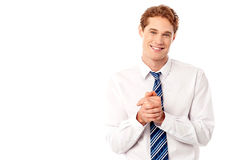 Corporate guy posing with clasped hands. Stylish businessman posing with clasped hands Royalty Free Stock Images