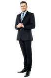 Corporate guy posing with clasped hands Royalty Free Stock Photo