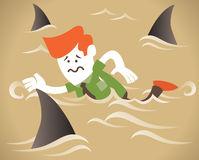 Corporate Guy swims with the sharks Royalty Free Stock Image