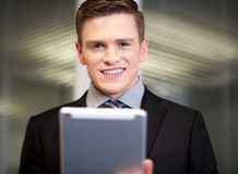 Corporate guy using tablet pc Stock Photography