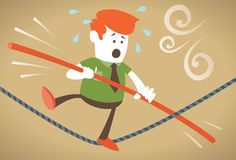 Corporate Guy walks the tightrope. Corporate Guy has trouble with his balance as he walks the tightrope Royalty Free Stock Photography