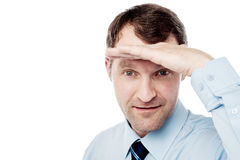 Corporate guy watching something closely Stock Photo