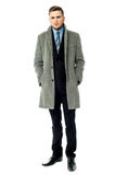 Corporate guy wearing long overcoat. Businessman wearing trendy overcoat over white Royalty Free Stock Image