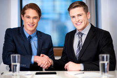 Corporate guys shaking hands Stock Photography
