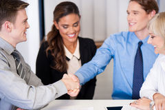 Corporate guys shaking hands Stock Images
