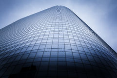 Corporate Headquarters. Large glass office building with colour treatment and vignette Stock Image
