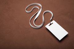 Corporate Identification badge  on rustic brown background stock photo