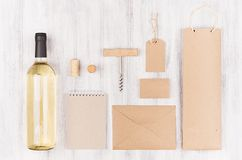 Corporate identity mock up for wine industry,  blank beige kraft packaging, stationery, merchandise set with bottle white wine on Royalty Free Stock Photo