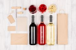 Corporate identity mock up for wine industry - blank packaging, stationery set on soft white wood background. Stock Image