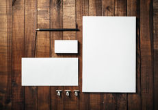 Corporate identity set. Blank stationery set on wood table background. Corporate identity template. Letterhead, business cards, envelope and pencil. Mock-up for Royalty Free Stock Photos