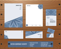 Corporate Identity Set: Presentation Folder, Letterhead, Envelope, Compliment Slip, Corporate Flyer, Business Card on Wood texture Stock Photo