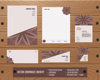 Corporate Identity Set: Presentation Folder, Letterhead, Envelope, Compliment Slip, Corporate Flyer, Business Card on Wood texture Stock Photo