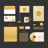 Corporate identity template. Logo and design elements. Golden style. Corporate identity template. Logo and design elements. Golden style on a dark background Royalty Free Stock Images