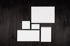 Corporate identity template, stationery on black stylish wood background. Mock up for branding, graphic designers presentations an. D portfolios Stock Images