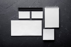 Corporate identity template, stationery on dark grey concrete texture. Mock up for branding, graphic designers presentations and p Stock Image