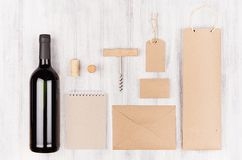Corporate identity template for wine industry, blank beige kraft packaging on soft white wood background. Royalty Free Stock Photos