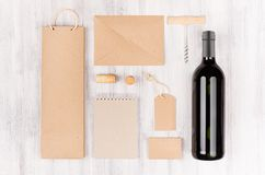 Corporate identity template for wine industry, blank brown kraft packaging, stationery, merchandise set with bottle red wine on s