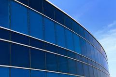 Corporate Industrial Building. The view of the galss concrete office on the blue sky background Royalty Free Stock Photo