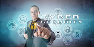 Corporate Investigator Activating CYBER SECURITY. Friendly corporate investigator with a vigorous gesture is activating CYBER SECURITY on an interactive screen stock image