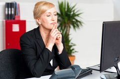 Corporate lady looking into computer screen Stock Images