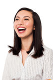 Corporate lady looking up and laughing. Attractive young business lady looking up and laughing Stock Images