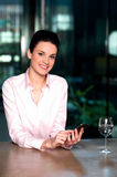 Corporate lady messaging through mobile phone Royalty Free Stock Photography