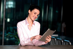 Corporate lady operating new tablet device Stock Photo
