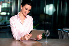 Corporate lady operating new tablet device Stock Image