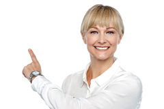 Corporate lady pointing backwards. Copy space concept stock photo