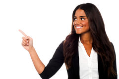 Corporate lady pointing towards copy space area Royalty Free Stock Images