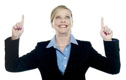 Corporate lady pointing upwards with both hands Stock Photos