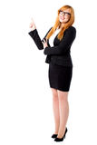 Corporate lady pointing upwards Stock Images