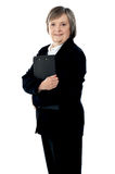 Corporate lady posing with documents Stock Photo