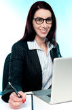 Corporate lady posing with pen in hand Royalty Free Stock Photo