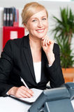 Corporate lady preparing tomorrows schedule Royalty Free Stock Image