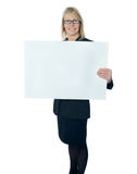 Corporate lady promoting blank placard Stock Photos