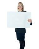 Corporate lady promoting blank placard Stock Photos