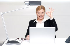 Corporate lady showing excellent gesture Stock Images