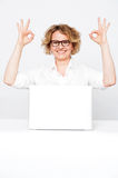 Corporate lady showing excellent gesture Royalty Free Stock Photos