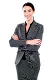 Corporate lady standing with her arms crossed Stock Photo