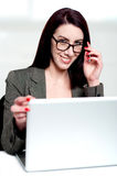 Corporate lady about to shutdown laptop Stock Photo