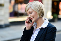 Corporate lady using her phone Stock Photos